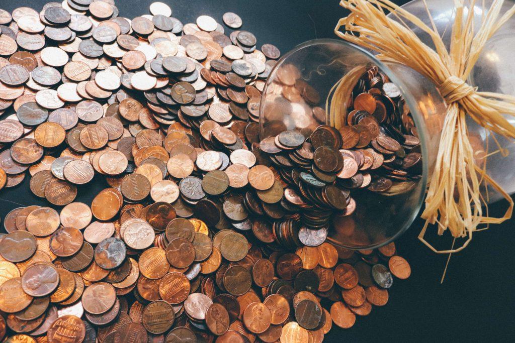 Uang koin yang ditabung akan memberikan keuntungan